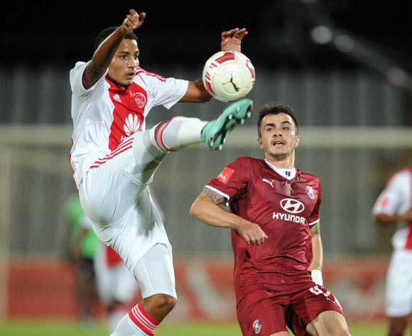 Rivaldo Coetzee of Ajax Cape Town battles with Vladimir Mandic of Moroka Swallows during the Absa Premiership match between Moroka Swallows and Ajax Cape Town on the 03 December 2014 at Dobsonville Stadium