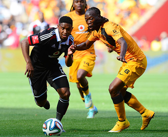 Thandani Ntshumayelo of Orlando Pirates and Reneilwe Letsholonyane of Kaizer Chiefs during the Absa Premiership Football match between Orlando Pirates and Kaizer Chiefs at Soccer City in Johannesburg, South Africa on December 6, 2014 ©Barry Aldworth/BackpagePix
