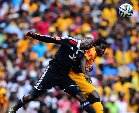 Kingston Nkhatha of Kaizer Chiefs and Rooi Mahamutsa of Orlando Pirates during the Absa Premiership Football match between Orlando Pirates and Kaizer Chiefs at Soccer City in Johannesburg, South Africa on December 6, 2014 ©Barry Aldworth/BackpagePix