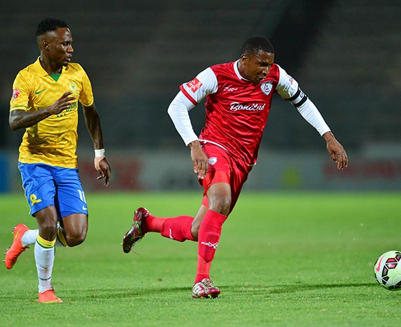 Teko Modise of Mamelodi Sundowns and Paulus Masehe of Free State Stars during the Absa Premiership Football match between Mamelodi Sundowns and Free State Stars at Lucas Moripe Stadium in Pretoria, South Africa on December 6, 2014 ©Barry Aldworth/BackpagePix