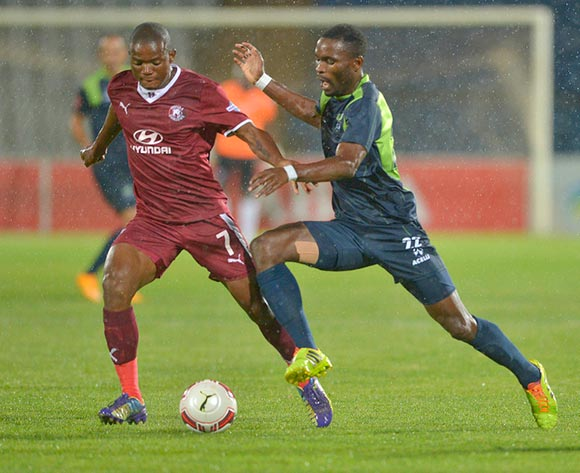Lantshene Phalane of Moroka Swallows and Robert Ng'ambi of Platinum Stars vie for the ballduring the Absa Premiership Football match between Moroka Swallows and Platinum Stars at Dobsonville Stadium  in Soweto , South Africa on December 6, 2014 ©Irwin Hackner/BackpagePix