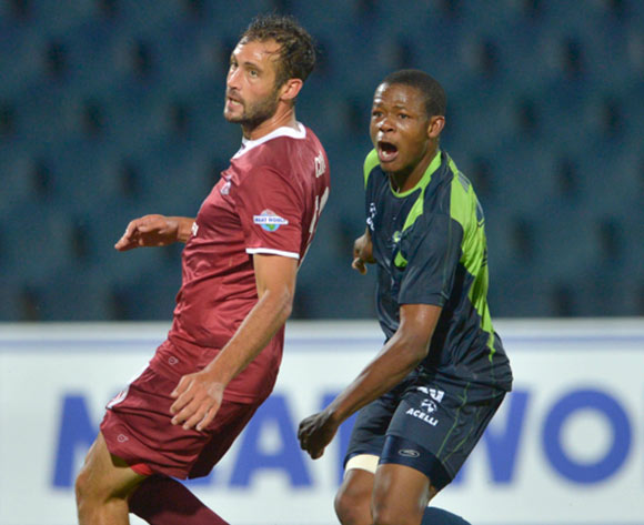 Larry Cohen of Moroka Swallows blocking a shot at goal  from. Ndumiso Mabena of Platinum Stars during the Absa Premiership Football match between Moroka Swallows and Platinum Stars at Dobsonville Stadium  in Soweto , South Africa on December 6, 2014 ©Irwin Hackner/BackpagePix