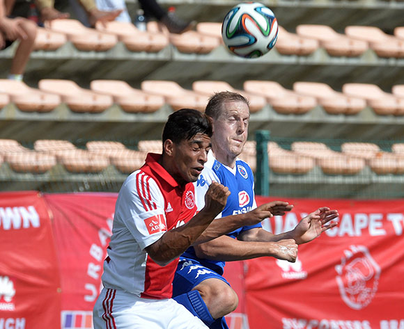 Michael Morton of Supersport United battles for the ball with Travis Graham of Ajax Cape Town during the Absa Premiership 2014/15 football match between Ajax Cape Town and SuperSport United at Athlone Stadium, Cape Town on 7 December 2014 ©Chris Ricco/BackpagePix