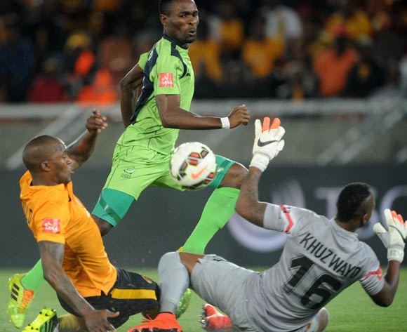 Robert Ngambi of Platinum Stars scores his goal while challenged by Morgan Gould and Brilliant Khuzwayo of Kaizer Chiefs during the Absa Premiership 2014/15 match between Kaizer Chiefs and Platinum Stars at Peter Mokaba Stadium, Polokwane on the 09 December 2014
