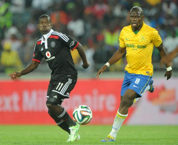 Sifiso Myeni of Orlando Pirates challenged by Hlompho Kekana of Mamelodi Sundowns during the Absa Premiership 2014/15 match between Orlando Pirates and Mamelodi Sundowns at Orlando Stadium, Soweto on the 10 December 2014