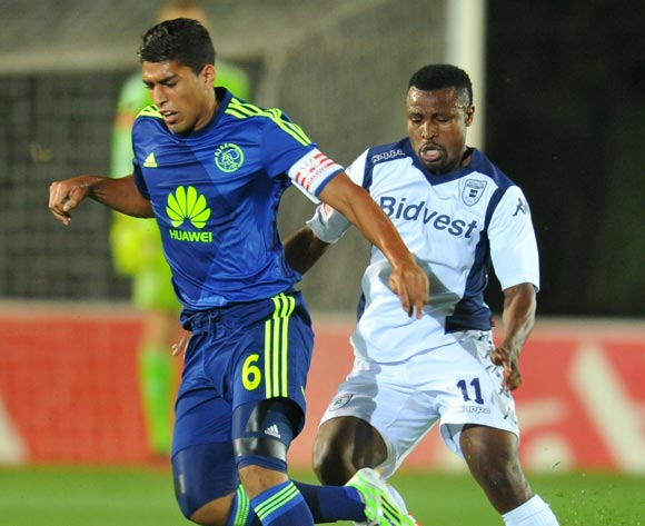 Travis Graham of Ajax Cape Town challenged by Chris Katongo of Bidvest Wits during the Absa Premiership 2014/15 football match between Bidvest Wits and Ajax Cape Town at the Bidvest Stadium in Johannesburg, South Africa on December 10, 2014