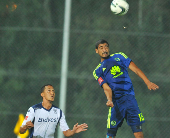 Abbubaker Mobara of Ajax Cape Town challenged by Henrico Botes of Bidvest Wits during the Absa Premiership 2014/15 football match between Bidvest Wits and Ajax Cape Town at the Bidvest Stadium in Johannesburg, South Africa on December 10, 2014