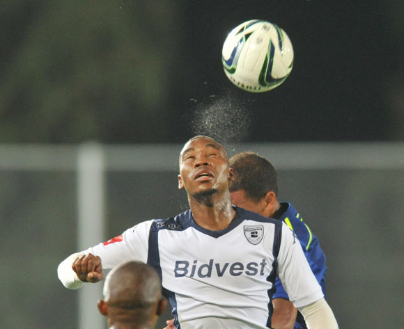 Sibusiso Vilakazi of Bidvest Wits challenged by Nazeer Allie of Ajax Cape Town during the Absa Premiership 2014/15 football match between Bidvest Wits and Ajax Cape Town at the Bidvest Stadium in Johannesburg, South Africa on December 10, 2014