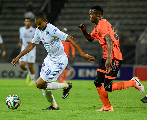 Prince Nxumalo of Supersport United and Joseph Musonda of Polokwane City F C during the Absa Premiership match between SuperSport United and Polokwane City on 13 December 2014 at  Lucas Moripe Stadium ©Frikkie Kapp /BackpagePix