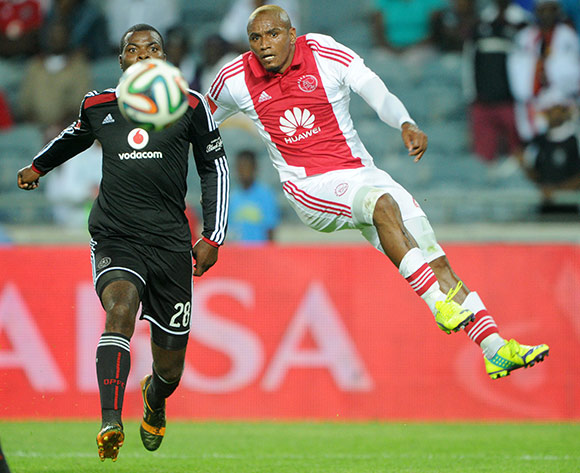 Franklin Cale of Ajax Cape Town challenged by Rooi Mahamutsa of Orlando Pirates during the Absa Premiership 2014/15 match between Orlando Pirates and Ajax Cape Town at Orlando Stadium, Soweto on the 13 December 2014  ©Muzi Ntombela/BackpagePix