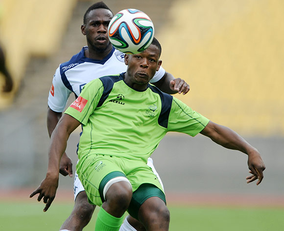 Ndumiso Mabena of Platinum Stars challenged by Onismor Bhasera of Bidvest Wits during the Absa Premiership 2014/15 match between Platinum Stars and Bidvest Wits at Royal Bafokeng Stadium, Rustenburg on the 14 December 2014  ©Muzi Ntombela/BackpagePix