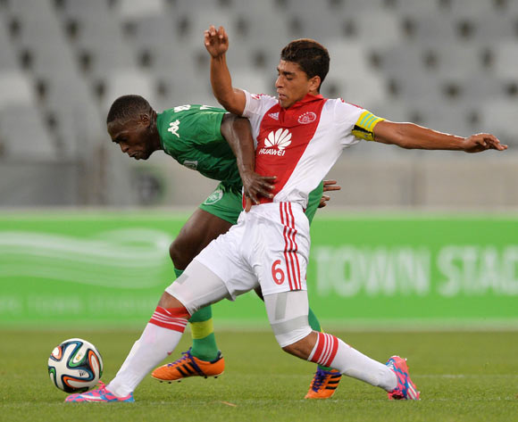 Carlington Nyadombo of AmaZulu tackled by Travis Graham of Ajax Cape Town during the Absa Premiership 2014/15 football match between Ajax Cape Town and AmaZulu at Cape Town Stadium, Cape Town on 16 December 2014
