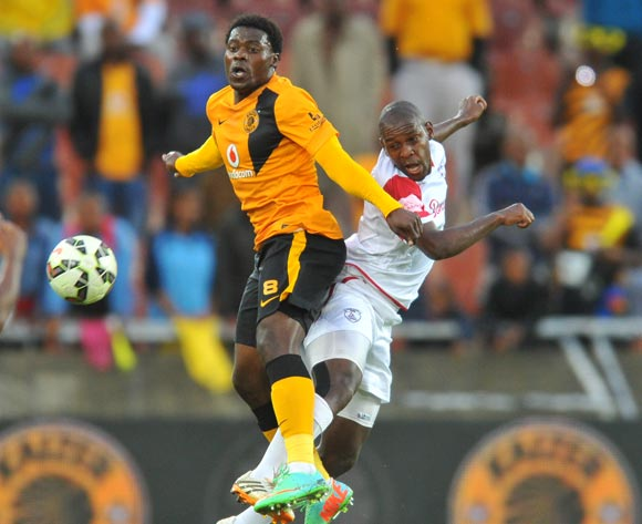 Kingston Nkhatha of Kaizer Chiefs challenged by Katlego Mashego of Free State Stars during the Absa Premiership 2014/15 football match between Kaizer Chiefs and Free State Stars at the Peter Mokaba Stadium in Polokwane, South Africa on December 16, 2014