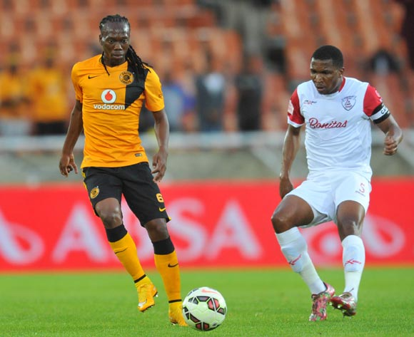Reneilwe Letsholonyane of Kaizer Chiefs challenged by Paulus Masehe of Free State Stars during the Absa Premiership 2014/15 football match between Kaizer Chiefs and Free State Stars at the Peter Mokaba Stadium in Polokwane, South Africa on December 16, 2014