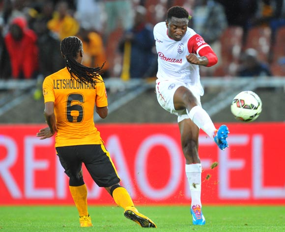 Moeketsi Sekola of Free State Stars challenged by Reneilwe Letsholonyane of Kaizer Chiefs during the Absa Premiership 2014/15 football match between Kaizer Chiefs and Free State Stars at the Peter Mokaba Stadium in Polokwane, South Africa on December 16, 2014