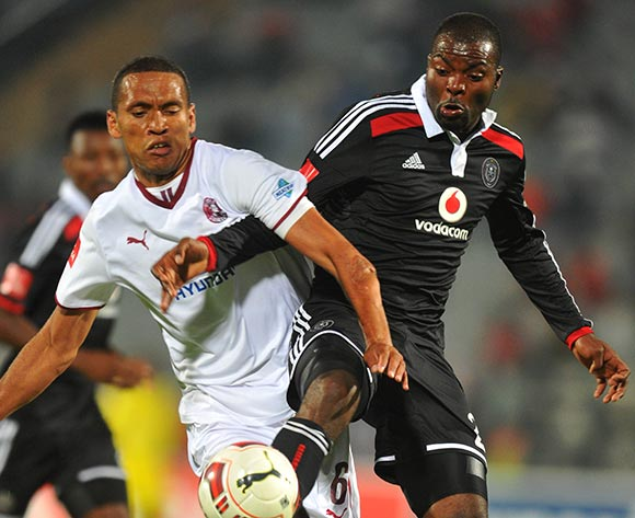 Ashraf Hendricks of Moroka Swallows challenged by Rooi Mahamutsa of Orlando Pirates during the Absa Premiership 2014/15 football match between Moroka Swallows and Orlando Pirates at the Dobsonville Stadium in Johannesburg, South Africa on December 17, 2014 ©Samuel Shivambu/BackpagePix