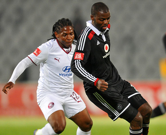 Rooi Mahamutsa of Orlando Pirates challenged by Lefa Tsutsulupa of Moroka Swallows during the Absa Premiership 2014/15 football match between Moroka Swallows and Orlando Pirates at the Dobsonville Stadium in Johannesburg, South Africa on December 17, 2014 ©Samuel Shivambu/BackpagePix