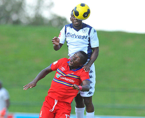Atusaye Nyondo of University of Pretoria challenged by Onismor Bhasera of Bidvest Wits during the Absa Premiership 2014/15 football match between University of Pretoria and Bidvest Wits at the Tuks Stadium in Pretoria, South Africa on December 21, 2014 ©Samuel Shivambu/BackpagePix