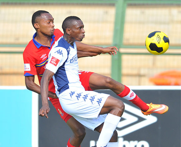 Siyabonga Nhlapho of Bidvest Wits challenged by Thabo Mnyamane of University Pretoria during the Absa Premiership 2014/15 football match between University of Pretoria and Bidvest Wits at the Tuks Stadium in Pretoria, South Africa on December 21, 2014 ©Samuel Shivambu/BackpagePix