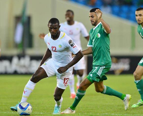 Stephane Badji of Senegal gets away from Riyad Mahrez of Algeria  during the 2015 Africa Cup of Nations football match between Algeria and Senegal at Malabo Stadium, Malabo, Equatorial Guinea on 27 January 2015