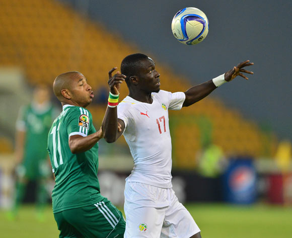 Idrissa Gana Gueye of Senegal clears ball from Yacine Brahimi of Algeria during the 2015 Africa Cup of Nations football match between Algeria and Senegal at Malabo Stadium, Malabo, Equatorial Guinea on 27 January 2015