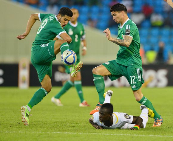 Saphir Taider (l) and Carl Medjani of Algeria clears ball from Sadio Mane of Senegal during the 2015 Africa Cup of Nations football match between Algeria and Senegal at Malabo Stadium, Malabo, Equatorial Guinea on 27 January 2015