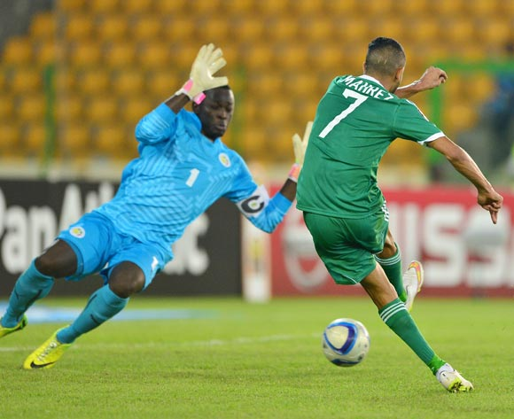 Riyad Mahrez of Algeria scores past Bouna Coundoul of Senegal during the 2015 Africa Cup of Nations football match between Algeria and Senegal at Malabo Stadium, Malabo, Equatorial Guinea on 27 January 2015