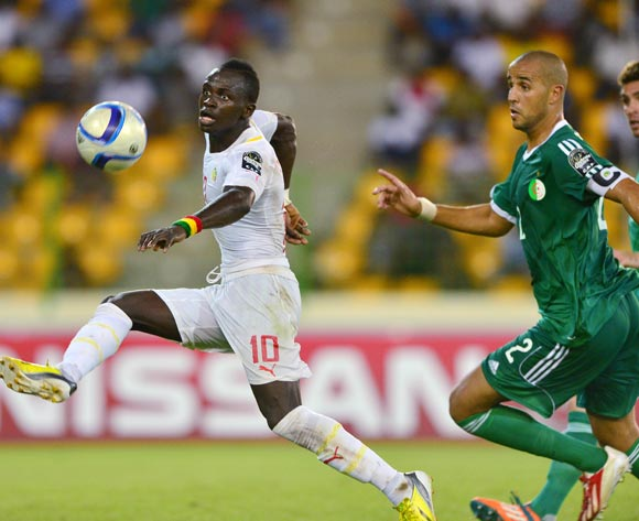 Sadio Mane of Senegal clears ball from Madjid Bouguerra of Algeria during the 2015 Africa Cup of Nations football match between Algeria and Senegal at Malabo Stadium, Malabo, Equatorial Guinea on 27 January 2015