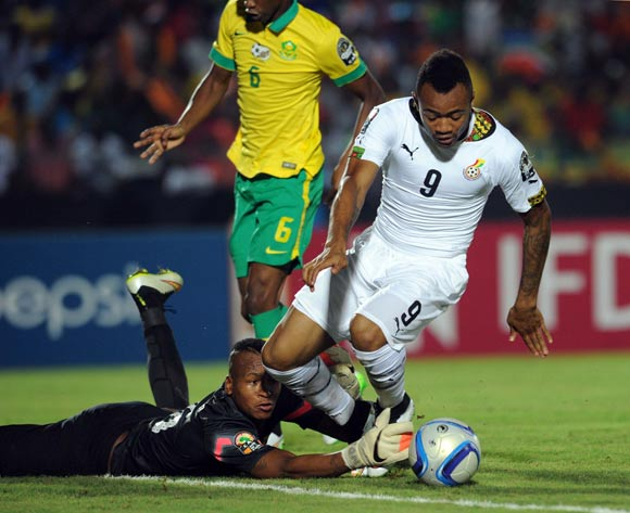 Brilliant Khuzwayo of South Africa battles with Jordan Ayew of Ghana  during of the 2015 Africa Cup of Nations match between South Africa and Ghana at Mongomo Stadium, Equatorial Guinea on 27 January 2015