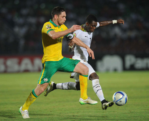 Dean Furman of South Africa battles with Christian Atsu of Ghana on Tuesday
