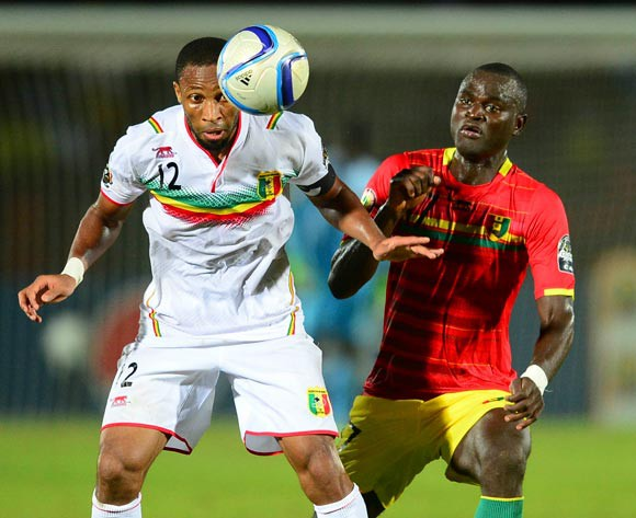 Seydou Keita of Mali and Abdoul Razzagui Camara of Guinea during the 2015 Africa Cup of Nations football match between Guinea and Mali at the Mongomo Stadium in Mongomo, Equatorial Guinea on 28 January 2015