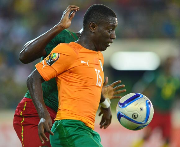 Max Gradel of Ivory Coast controls ball from Jerome Guihoata of Cameroon during the 2015 Africa Cup of Nations football match between Cameroon and Ivory Coast at Malabo Stadium, Malabo, Equatorial Guinea on 28 January 2015