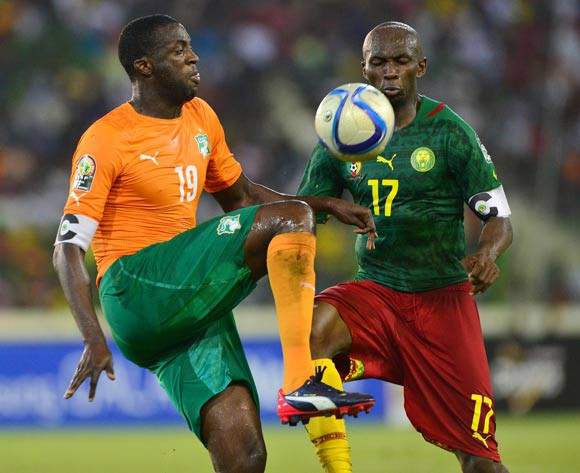 Yaya Toure of Ivory Coast (l) knees ball away from Stephane Mbia of Cameroon  during the 2015 Africa Cup of Nations football match between Cameroon and Ivory Coast at Malabo Stadium, Malabo, Equatorial Guinea on 28 January 2015