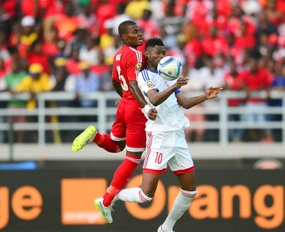 Diosdado Mangue Mbele of Equatorial Guinea and Fode Dore of Congo during the 2015 Africa Cup of Nations football match between Equatorial Guinea and Congo at Bata Stadium in Bata, Equatorial Guinea on 17 January 2015