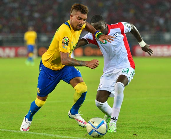 Frederic Bulot of Gabon and Kiswendsida Narcisse Bambara of Burkina Faso during the 2015 Africa Cup of Nations football match between Burkina Faso v Gabon at Bata Stadium in Bata, Equatorial Guinea on 17 January 2015