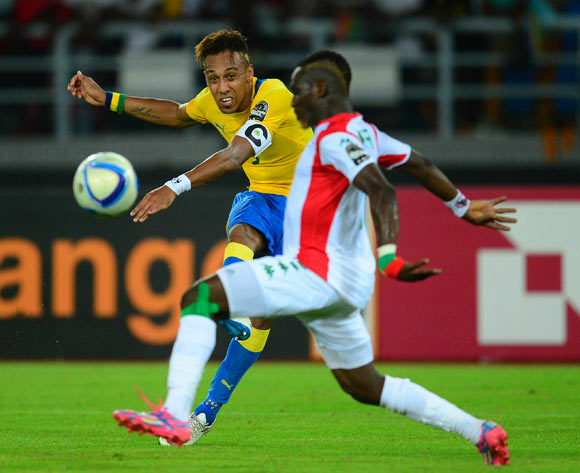 Pierre Aubameyang of Gabon (L) takes a shot at goal past Mohamed Koffi of Burkina Faso (R) during the 2015 Africa Cup of Nations football match between Burkina Faso v Gabon at Bata Stadium in Bata, Equatorial Guinea on 17 January 2015