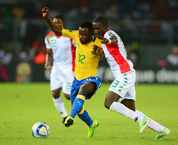 Guelor Kanga Kaku of Gabon and Kiswendsida Narcisse Bambara of Burkina Faso during the 2015 Africa Cup of Nations football match between Burkina Faso v Gabon at Bata Stadium in Bata, Equatorial Guinea on 17 January 2015