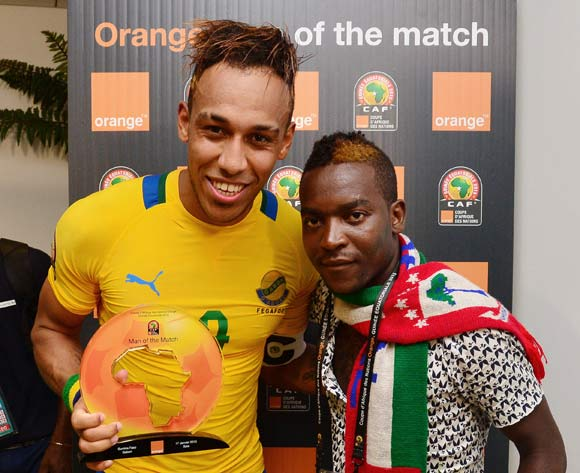 Pierre Aubameyang of Gabon receives Orange Man of the Match from the Orange fan of the Match during the 2015 Africa Cup of Nations football match between Burkina Faso and Gabon at the Bata Stadium, Bata, Equatorial Guinea on 17 January 2015