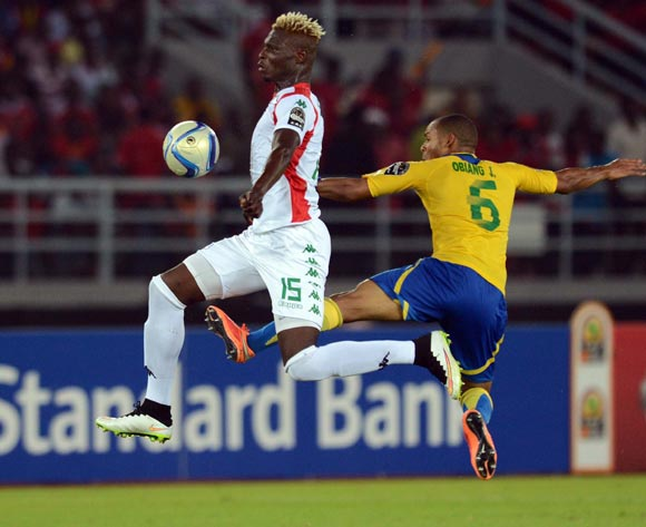 Aristide Bance of Burkina Faso battles with Johann Obiang of Gabon during of the 2015 Africa Cup of Nations match between Burkina Faso and Gabon at Bata Stadium, Equatorial Guinea on 17 January 2015