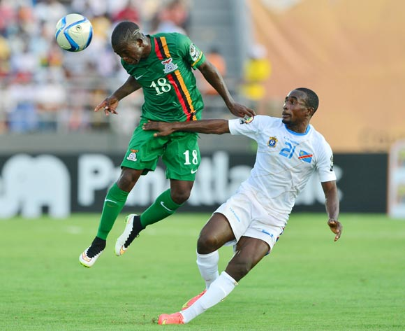 Emmanuel Mbola of Zambia heads ball away from Firmin Ndombe Mubele of DR Congo  during the 2015 Africa Cup of Nations football match between Zambia and DR Congo at the Ebibeyin Stadium, Ebibeyin, Equatorial Guinea on 18 January 2015