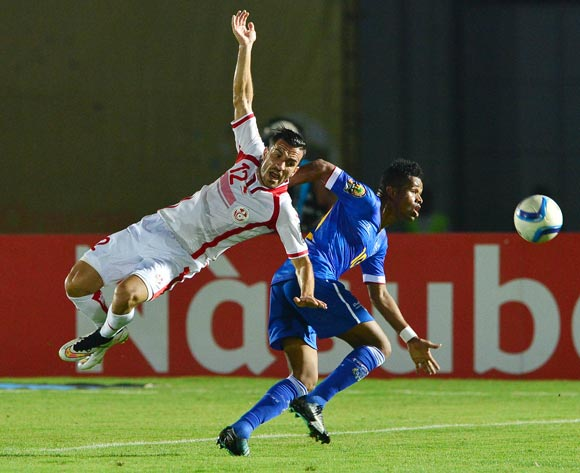 Ali Maaloul of Tunisia challenged by Heldon of Cape Verde during the 2015 Africa Cup of Nations football match between Tunisia and Cape Verde  at the Ebibeyin Stadium, Ebibeyin, Equatorial Guinea on 18 January 2015