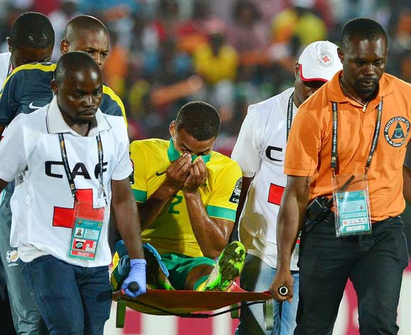 Rivaldo Coetzee of South Africa reacts in pain after being stretched off field during the 2015 Africa Cup of Nations football match between Algeria and South Africa at Mongomo Stadium, Mongomo, Equatorial Guinea on 19 January 2015