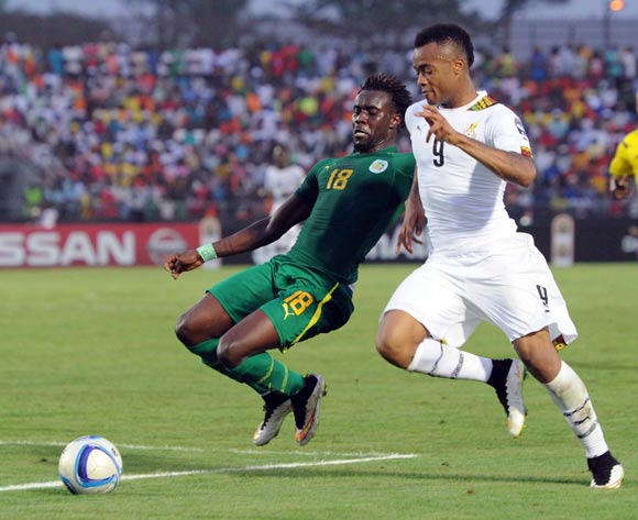 Jordan Ayew of Ghana (right) battles with Pape Ndiaye Souare of Senegal on Monday
