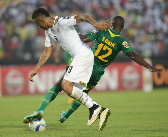 Jordan Ayew of Ghana battles with Stephane Badji of Senegal  during of the 2015 Africa Cup of Nations match between Senegal and  Ghana at Mongomo Stadium, Equatorial Guinea on 19 January 2015