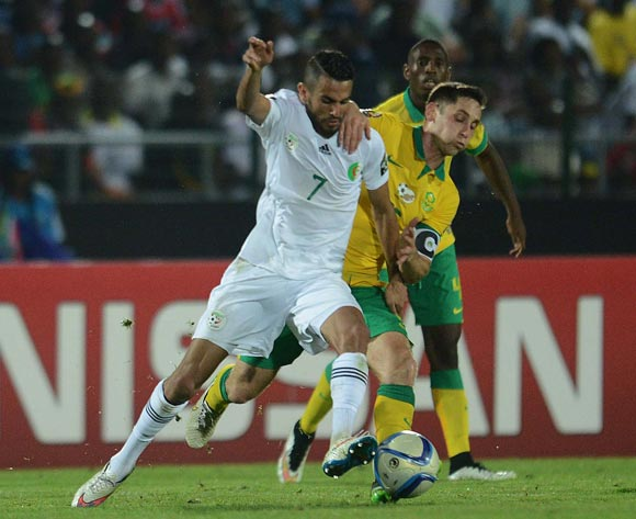 Dean Furman of South Africa battles with Riyad Mahrez of Algeria during of the 2015 Africa Cup of Nations match between Algeria and South Africa at Mongomo Stadium, Equatorial Guinea on 19 January 2015