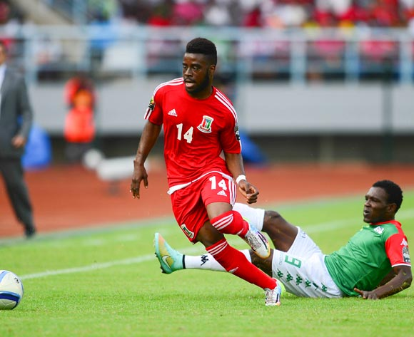 Enrique Boula Senobua of Equatorial Guinea and Issa Gouo of Burkina Faso during the 2015 Africa Cup of Nations football match between Equatorial Guinea and Burkina Faso at the Bata Stadium in Bata, Equatorial Guinea on 21 January 2015