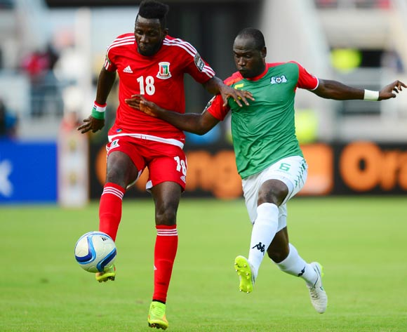 Viera Ellong Doualla of Equatorial Guinea and Djakaridja Kone of Burkina Faso during the 2015 Africa Cup of Nations football match between Equatorial Guinea and Burkina Faso at the Bata Stadium in Bata, Equatorial Guinea on 21 January 2015