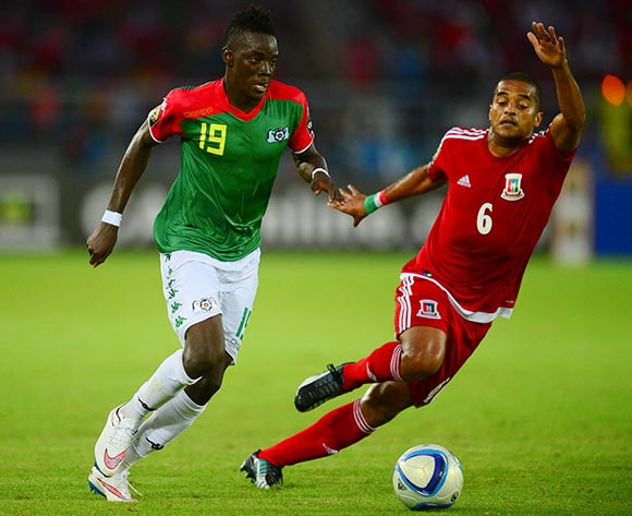 Bertrand Traore of Burkina Faso and Juvenal Edjogo of Equatorial Guinea  at 2015 AFCON