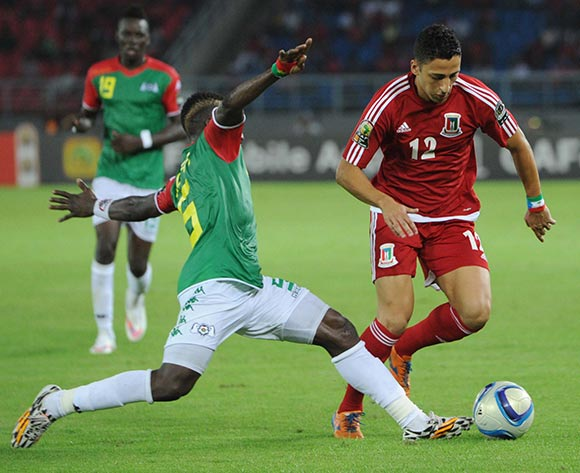 Ivan Bolado Palacios of Equatorial Guinea dribbles past Mohamed Koffi of Burkina Faso during of the 2015 Africa Cup of Nations match between Equatorial Guinea and Burkina Faso at Bata Stadium, Equatorial Guinea on 21 January 2015 Pic Sydney Mahlangu/BackpagePix