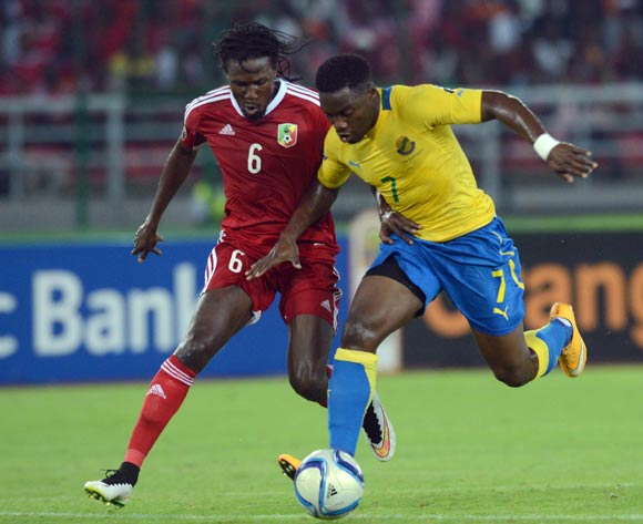 Dimitri Davy Bissiki of Congo battles with Malick Evouna of Gabon during of the 2015 Africa Cup of Nations match between Gabon and Congo at Bata Stadium, Equatorial Guinea on 21 January 2015